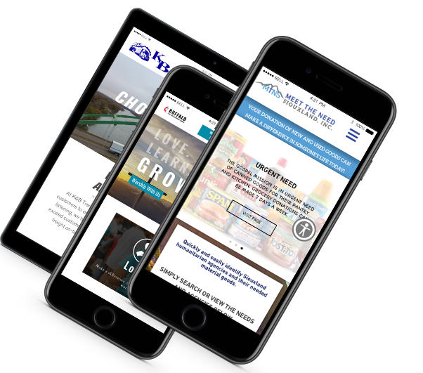 Tablet and two iphones showing mocked up web designs